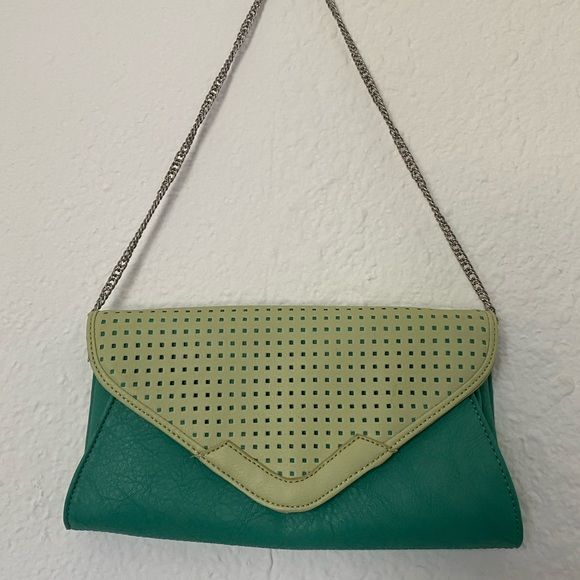 Pale pistachio and mint purse with silver strap.